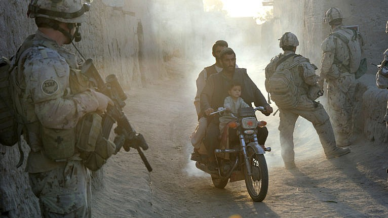 Passing through an early morning checkpoint in Kandahar in 2011, the year Canadian soldiers were brought home (Courtesy of Sergeant Matthew McGregor/DND-MDN)