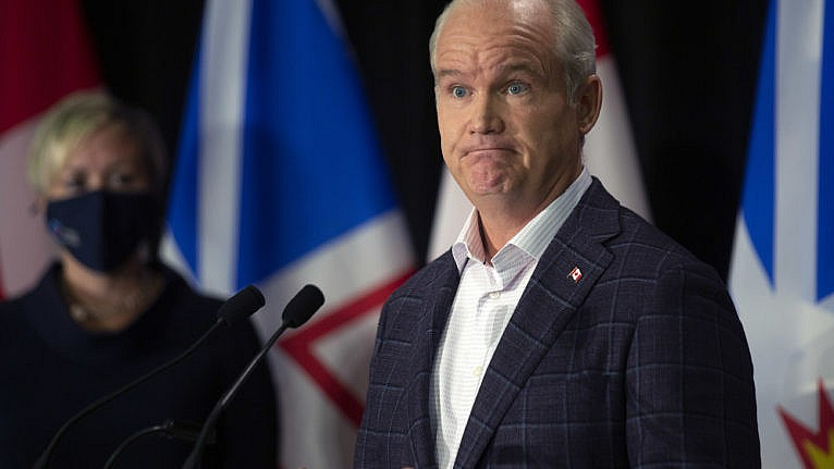 O'Toole takes questions from the media during a press conference in downtown St. John's, N.L. on July 26, 2021 (Paul Daly/CP)