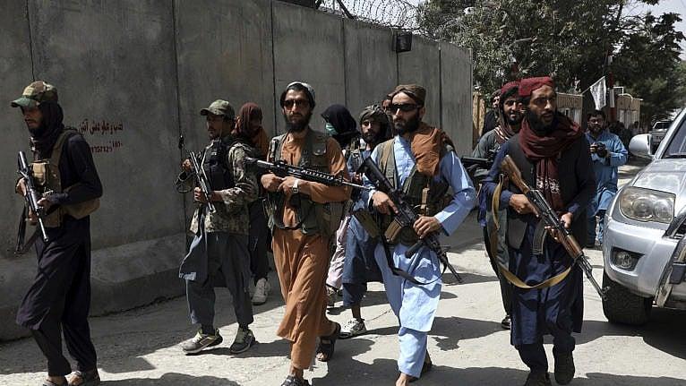 Taliban fighters patrol in Wazir Akbar Khan neighborhood in the city of Kabul on Aug. 18, 2021 (AP Photo/Rahmat Gul)