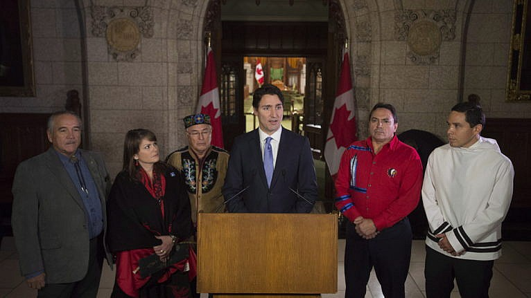 Trudeau speaks with national Indigenous leaders on Parliament Hill on Dec. 16, 2015 (Adrian Wyld/CP)
