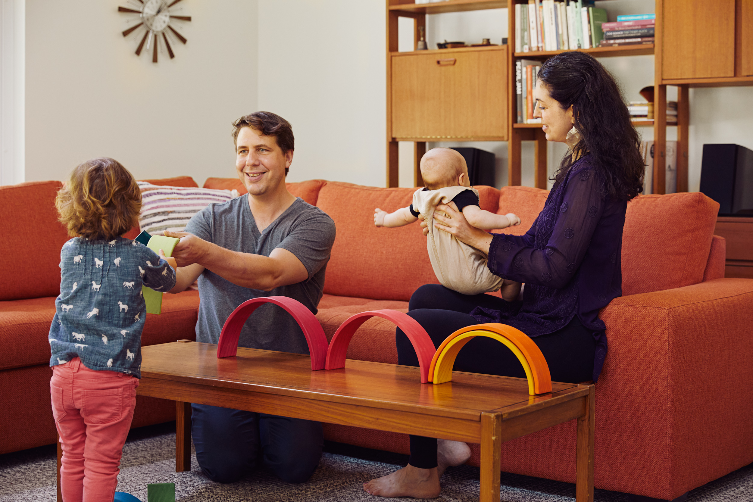 Norbert and Lisa play with their children in thie Quebec home. (Photograph by Sylvie Li)