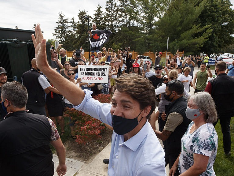 Demonstrators shout as Justin Trudeau, Canada's prime minister, arrives to campaign stop in Nobleton, Ontario, Canada, on Friday, Aug. 27, 2021. Trudeaus campaign rally in Bolton, Ontario, was canceled over security concerns amid protests. (Cole Burston/Bloomberg/Getty Images)