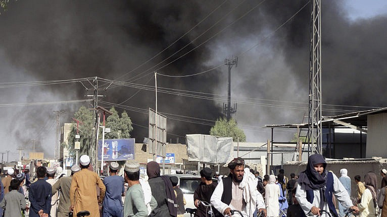 Smoke rises in Kandahar after fighting on Thursday between the Taliban and Afghan security personnel. The Taliban say they've taken control of the city. (Sidiqullah Khan/AP)
