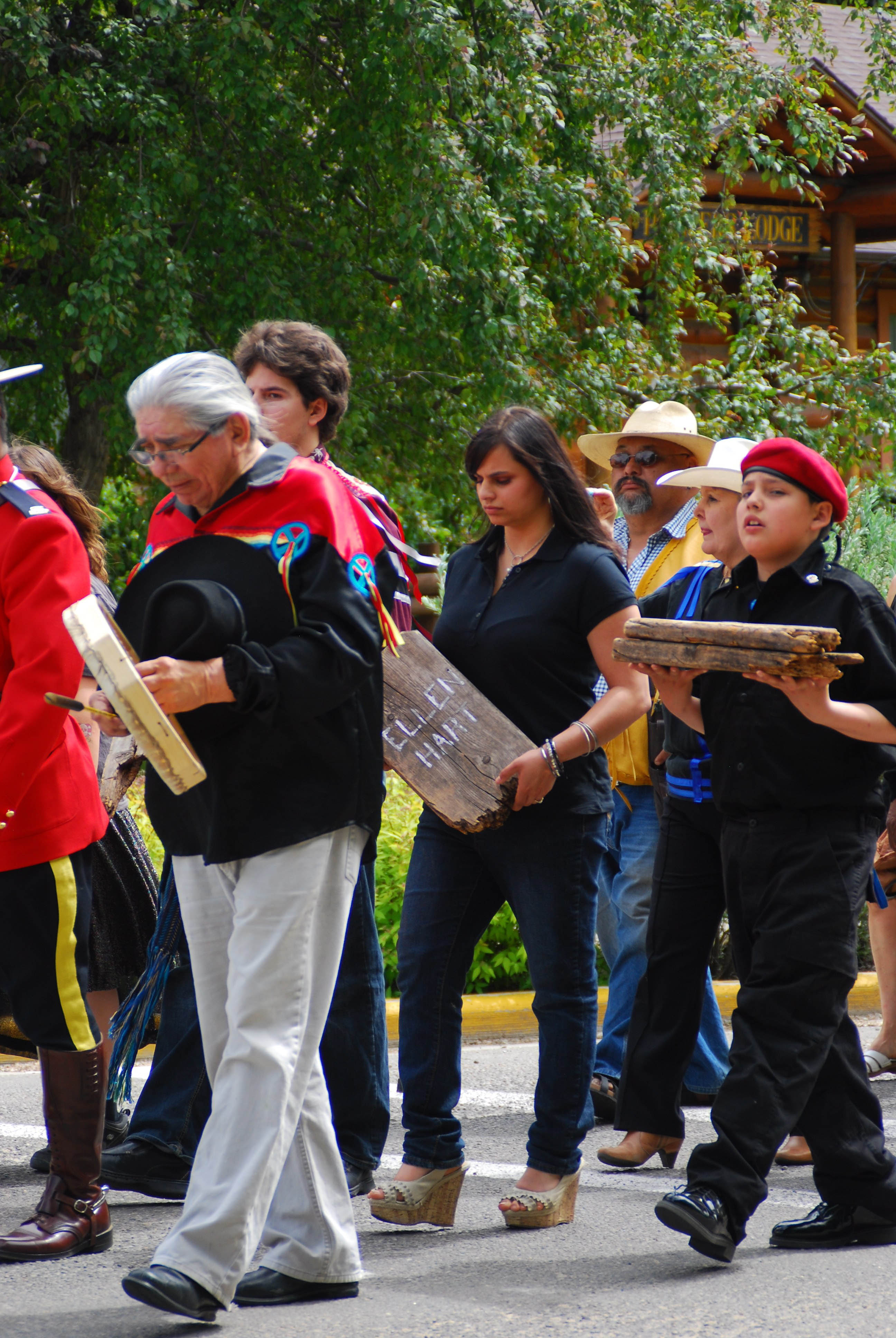 Adriana DuVal (centre) and Talon Lightning (right) carry headboards from the Red Deer Industrial School cemetery. The headboards belonged to students who had attended the school from 1893 to 1919. They will be on display at the Red Deer Musuem + Art Gallery. (Red Deer Express)