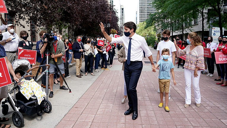 Liberal Party Leader Justin Trudeau greets a crowd of supporters with his family in tow after triggering a federal election, in Ottawa, Sunday, Aug. 15, 2021. THE CANADIAN PRESS/Sean Kilpatrick