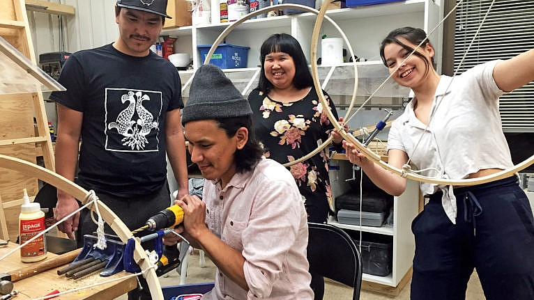NS students make their own drums, assisted by artist-in-residence Alex Angnaluak (seated)(Courtesy of Courtesy of Nunavut Sivuniksavut)
