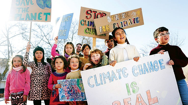 Children holding climate change signs