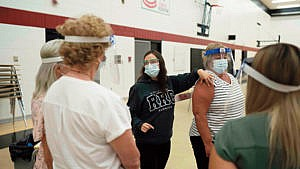 An instructor showing how to vaccinate a patient at Red River College (Photograph by Skye Spence)