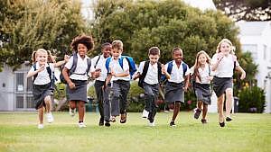 Private School Kids running in field