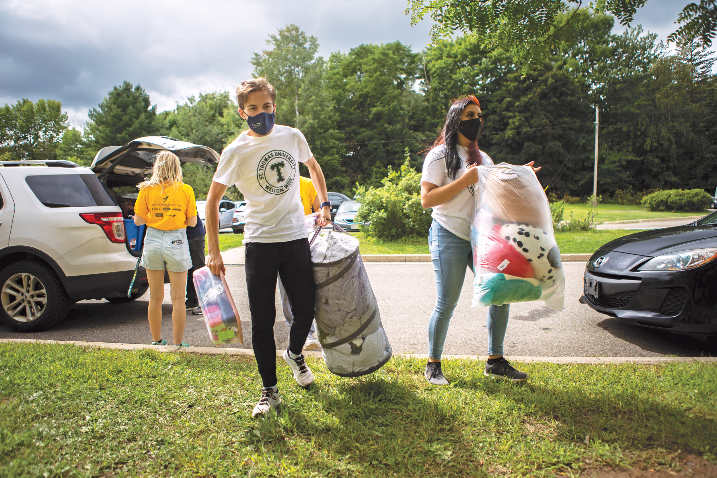 A volunteer helps a new student move into residence at St. Thomas University in Fredericton; universities are seeing an increase in demand for student housing(Photograph by Chris Donovan)