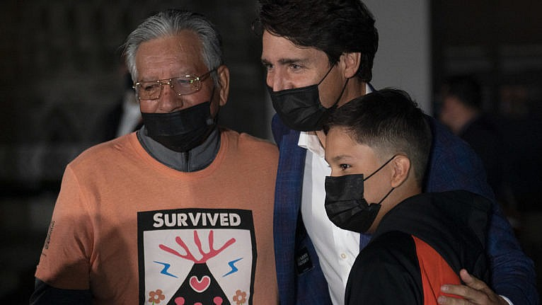 A survivor and family with Justin Trudeau on Parliament Hill on the eve of the first National Day of Truth and Reconciliation, September 29, 2021. (Adrian Wyld/Canadian Press)